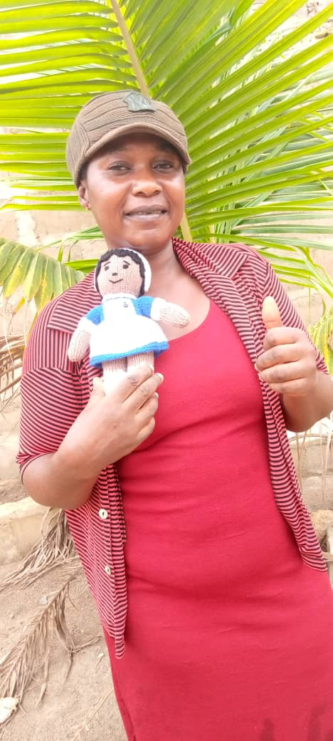 Jane with knitted doll mascot made by a UK supporter